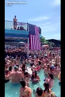 St. Louis County issued a travel advisory after videos (screengrab posted  above) showed crowds of people partying at Lake of the Ozarks bars.