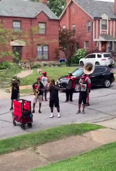 Lola gets a special birthday visit from the Red and Black Brass Band.