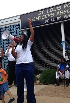 Cori Bush in 2017 leads protesters in a chant in front of the St. Louis Police Officers Association.