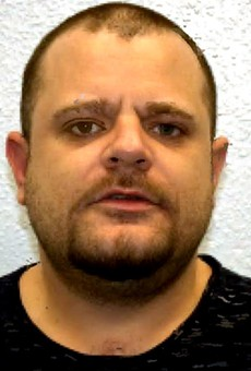 A mugshot of Nathan Wyatt taken after his 2017 sentencing to fraud and extortion in London.