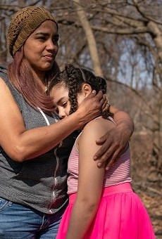 Alexandra Sierra and one of her daughters hug outside their home in Bergen County, New Jersey, on March 9.