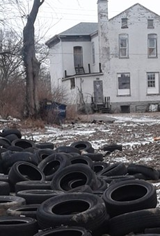 Piles of tires as they appeared in police photos of an illegal dumping site in north St. Louis.