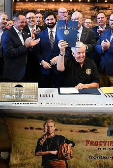 "Gov. Mike Parson celebrates the signing of Missouri's Second Amendment Preservation Act"" at a gun range."