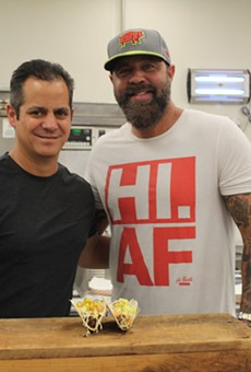 Jason Tilford, left, and Mike Johnson, right, pose for a photo in front of their new creation: the bacon cheeseburger taco.