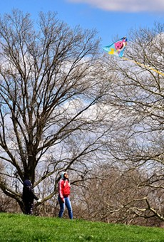 People flying a kite in Marquette Park in Dutchtown.
