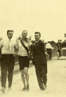 Thomas Hicks, one of the athletes in the 1904 Olympics, being supported by his trainers in the 24-mile marathon race.