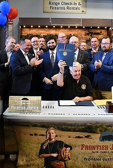 """Gov. Mike Parson celebrates the signing of Missouri's Second Amendment Preservation Act"""" at a gun range back in June."""