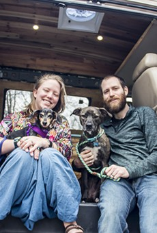Jayme and John Serbell and their dogs Nymeria and Crow are hitting the road in a 1996 Chevy Express conversion van.