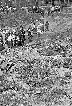 """Photos of the race riot's aftermath were published by the NAACP magazine The Crisis in September 1917. This photo's original caption read, """"Looking for bodies of victims. Six were found here."""""""