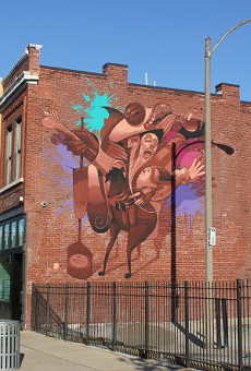 The mural on Sauce on the Side building has a food theme.