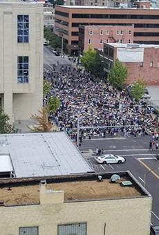Hundreds of people massed outside the St. Louis Metropolitan Police headquarters on the afternoon of Sunday, September 17.