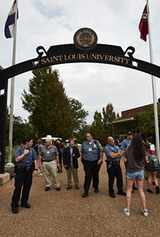 Police at St. Louis University posted at campus entrances during Sunday's protest march.