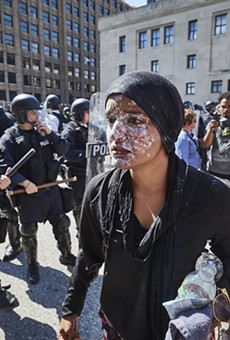 Maleeha Ahmad reacts after being pepper-sprayed by St. Louis officers.