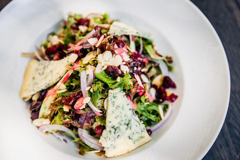 Louisiana sunburst salad with mixed greens, dried cranberries, toasted almonds,Stilton bleu cheese and a raspberry-port wine vinaigrette - COURTESY OF 1764 PUBLIC HOUSE