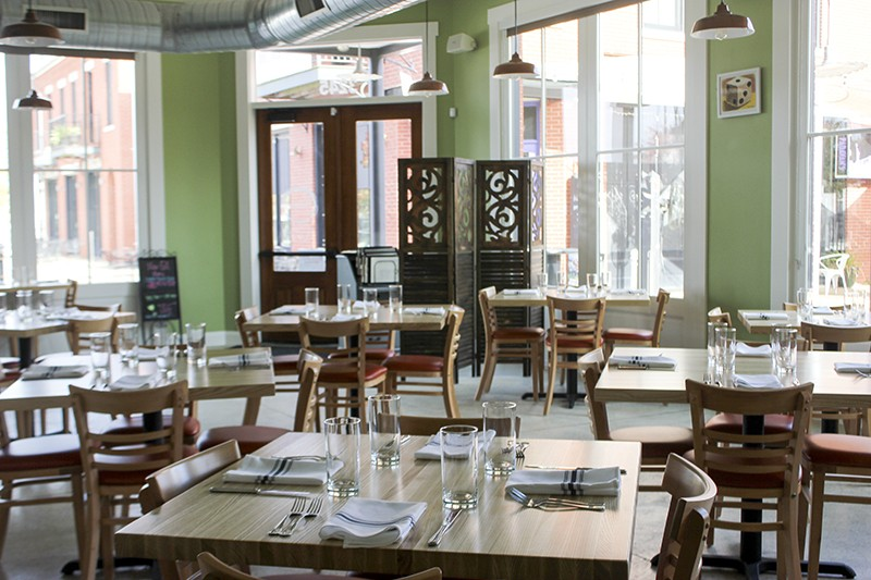 The light-filled dining room looks out onto New Town's charming business district. - CHERYL BAEHR