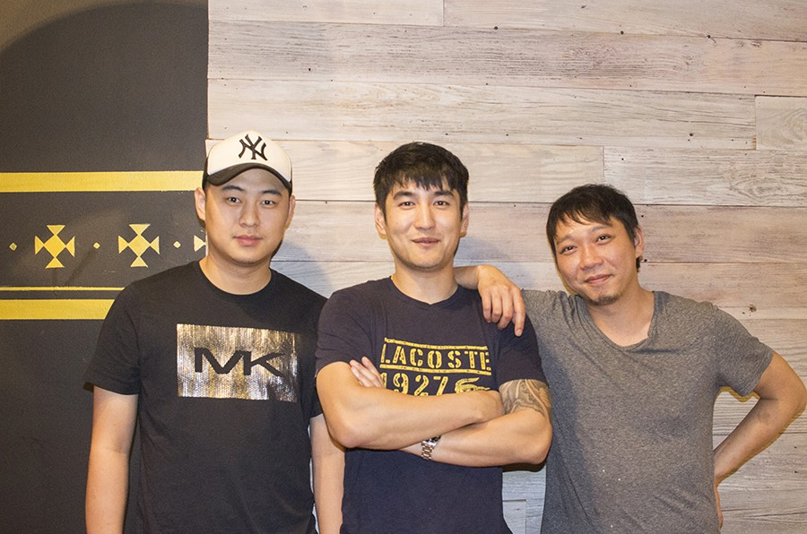 Co-owners Yijun Chen (center) and Yong Liu (right) with Bing Bing Manager Xun Lee. - MABEL SUEN