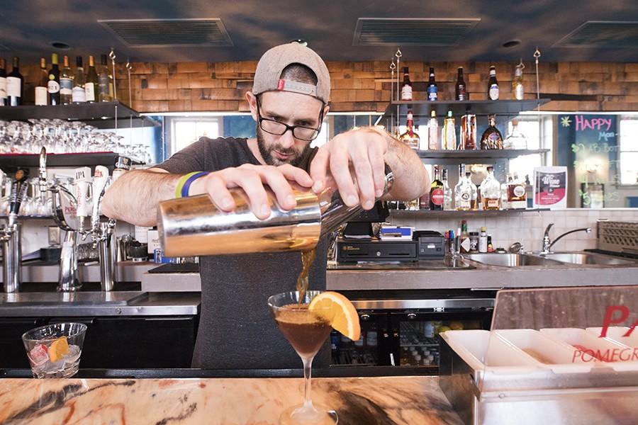 Bartender Bill Lehmann keeps the drinks coming. - MABEL SUEN