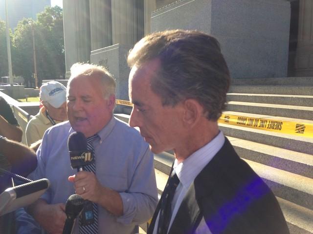 Attorney Albert Watkins speaks to reporters following ex-St. Louis police Office Jason Stockley's acquittal. - DOYLE MURPHY