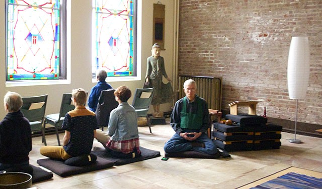 Dr. William Holcomb (facing forward) leads a session at downtown's new center. - COURTESY OF SHINZO ZEN MEDITATION CENTER