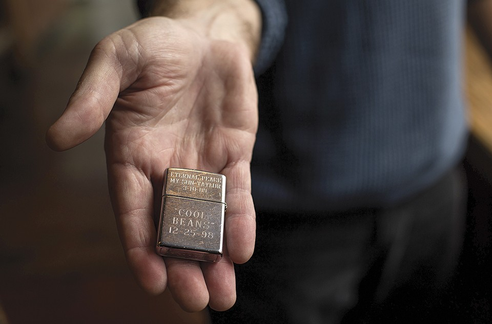 Hutchinson treasures mementoes from his son's life, including this Zippo lighter. - MONICA MILEUR