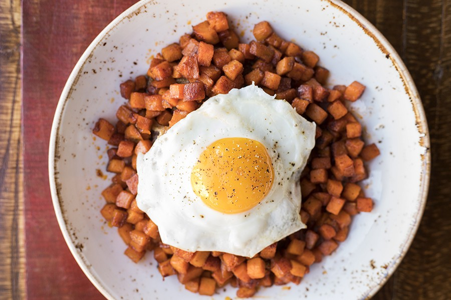 Hash with sweet potato, 100-layer apple, butterscotch, pork confit and fried egg. - MABEL SUEN