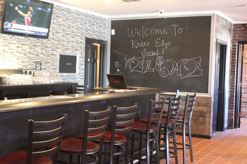 A large bar greets customers. - SARAH FENSKE