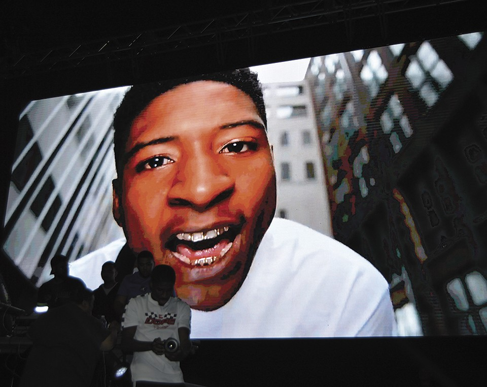 At a recent concert, LA4SS performed in front of blown-up images of his younger self. - BEN WESTHOFF