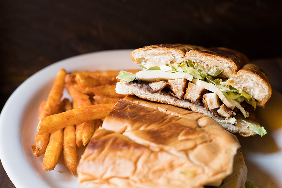 The Milanesa torta includes breaded chicken, refried beans, avocado, lettuce, tomato, onions, jalapenos, queso fresco and chipotle crema. - MABEL SUEN