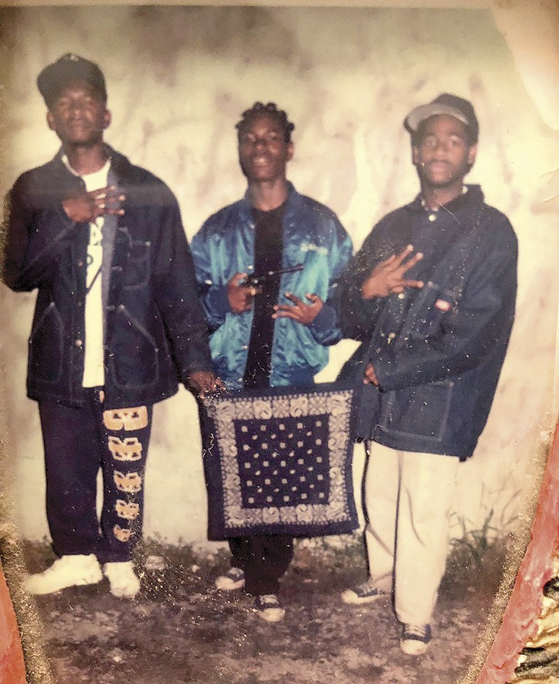 A 1992 photo of Sultan Muhammad (center) from his days as a Crip in the 41 Delmar Mob. - COURTESY OF SULTAN MUHAMMAD