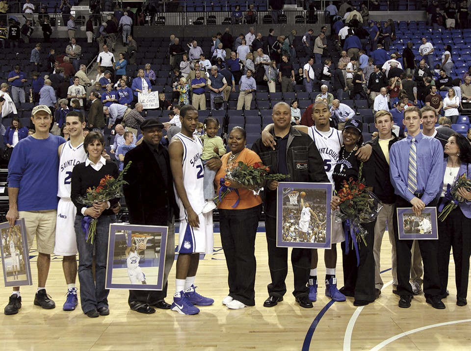 Liddell, center, stands with teammates on SLU's Senior Day in 2009. He chose to finish his career at the university rather than make a run at the NBA. - BILL BARRETT