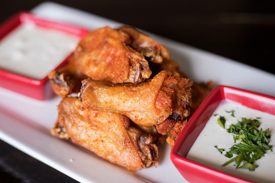 Wings are tossed in Red Hot Riplet spice and served with ranch or bleu cheese for dipping. - MABEL SUEN