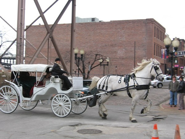 A horse-drawn carriage operates in Laclede's Landing. - FLICKR/STRAIGHTEDGE