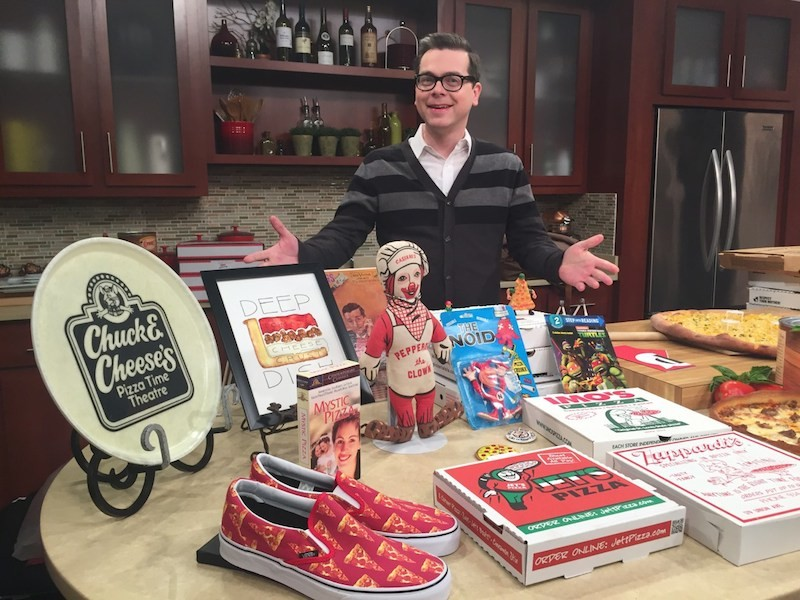 U.S. Pizza Museum founder Kendall Bruns with items from the museum's collection, which, yes, include an Imo's box. - COURTESY OF THE U.S. PIZZA MUSEUM