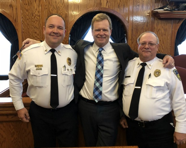 Two of the happy corrections officers with their attorney, Gary Burger, following a $113 million jury verdict. - COURTESY GARY BURGER LAW