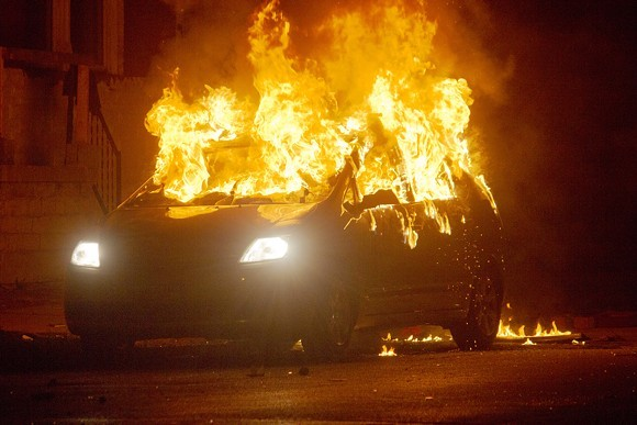 Neighbors lit a car on fire at Page and Walton in August 2015 to protest the police shooting of Mansur Ball-Bey. - DANNY WICENTOWSKI