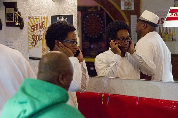 Wesley Bell takes a phone call on August 7, minutes before declaring victory over St. Louis County prosecutor Bob McCulloch. - DANNY WICENTOWSKI