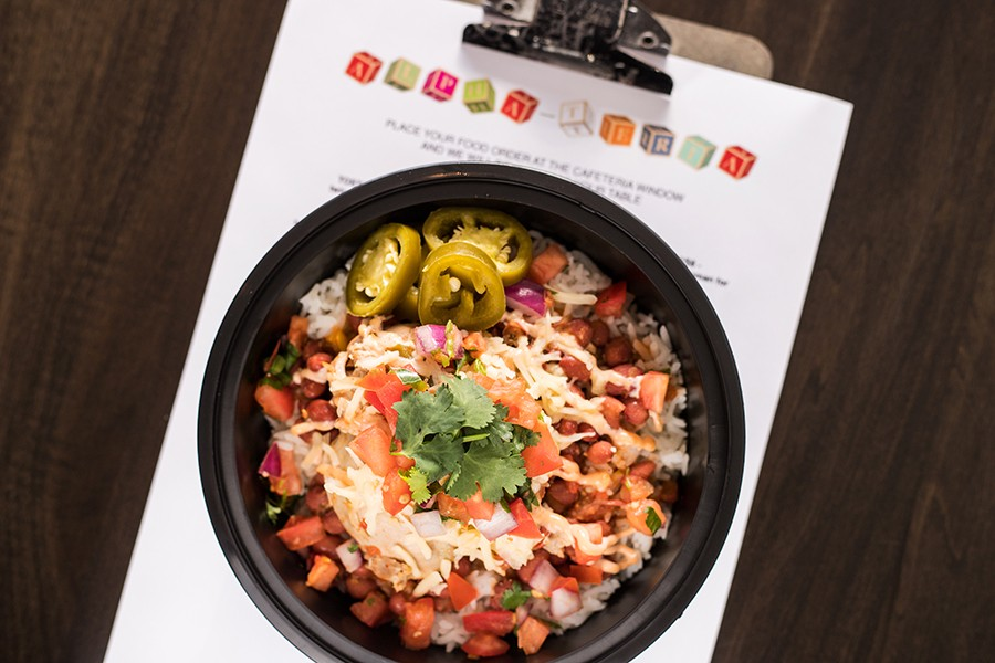 """The """"Mojo Chicken Bowl"""" combines citrus-braised chicken, red beans, rice, chipotle cream, pico de gallo, Chihuahua cheese and pickled jalapenos. - MABEL SUEN"""
