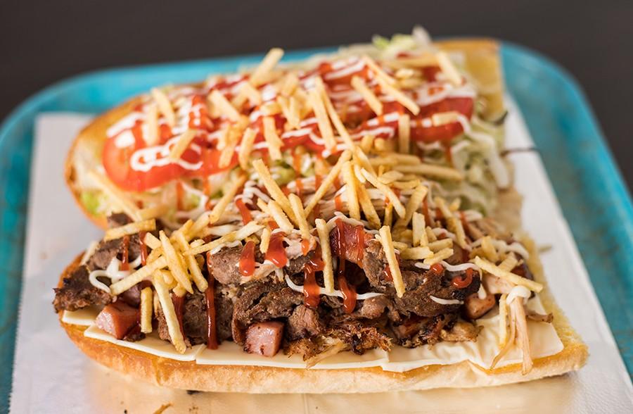 """""""La Tripleta"""" sandwich combines steak, pork and ham on toasted Cuban bread. - MABEL SUEN"""