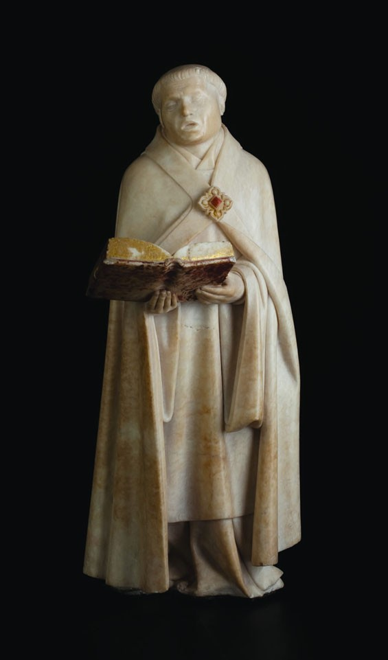 Jean de la Huerta and Antoine Le Moiturier, Mourner no. 48, cantor holding an open book in both hands, 1443–56/57, alabaster, 16.25 by 6.125 by 5.125 inches, Musee des Beaux-Arts, Dijon. © FRAME (French Regional and American Museum Exchange) by Jared Bendis and François JAY