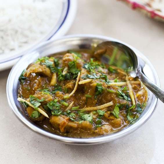 Chicken curry is chicken cooked in tomatoes and spices.