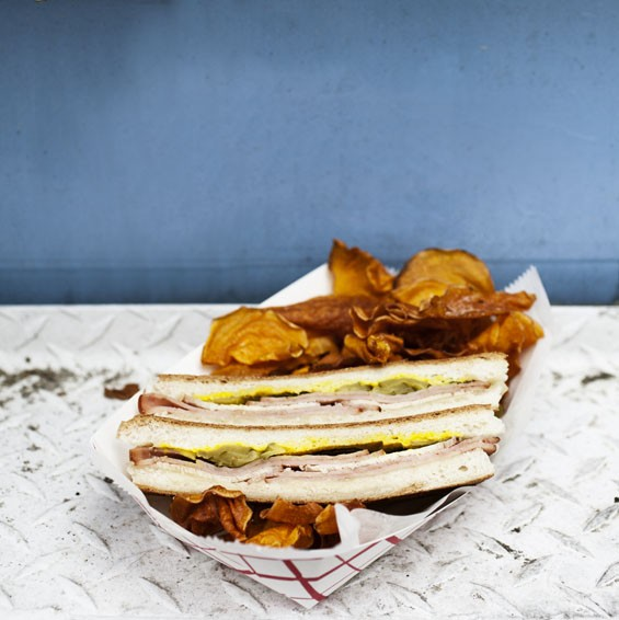 Shell's Coastal Cuisine's Cuban sandwich with sweet-potato chips.