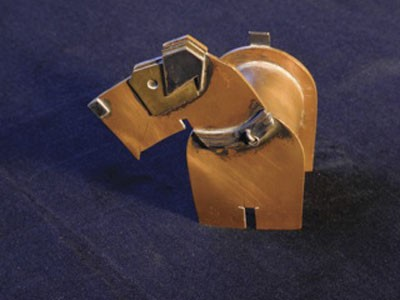 The copper, brass and silver Scottie dog by Ilse Shank.