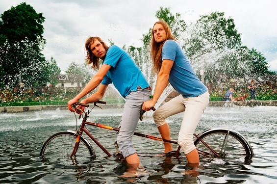 Menomena, on a tandem bike, in a fountain.