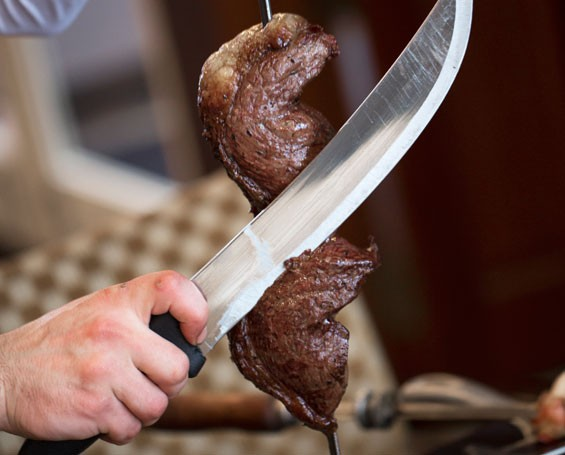 A skewer of Brazikat's picanha, a traditional Brazilian cut of beef.