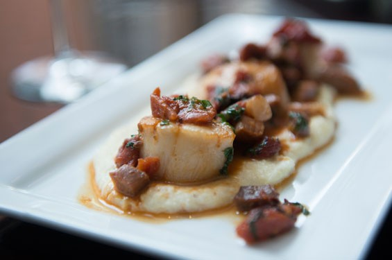 Robust's scallops come atop cheesy grits and are topped with ham and sun-dried tomatoes. Slideshow: Inside Robust on Washington Avenue.