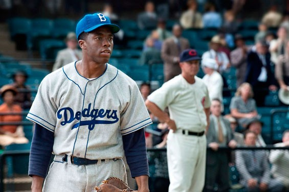 Chadwick Boseman as Jackie Robinson in 42.