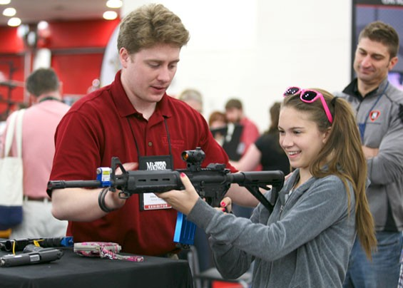 A young girl looked pretty comfortable holding a rifle, which is more than can be said for the author.