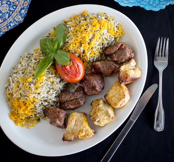 Beef and chicken shish kabob served with dill herb rice.