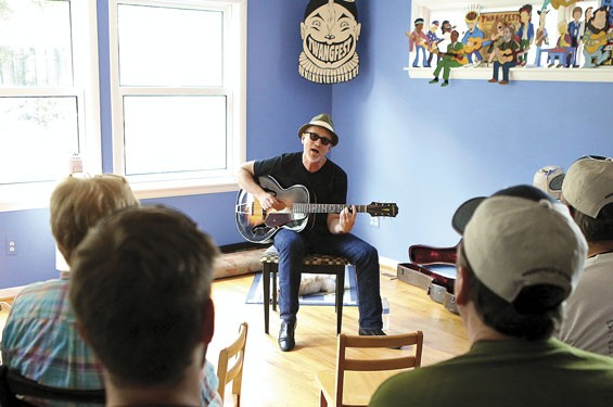 "Marshall Crenshaw playing one of Rick Wood's ""Wood House Concerts."""