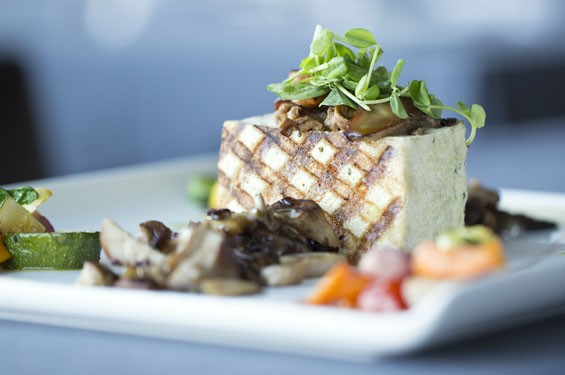 """Tofu: Marinated, Pressed, Grilled"" brings roasted Ozark mushrooms, paired with petit root vegetables and two celery coulis. See also: Panorama Restaurant Photos."